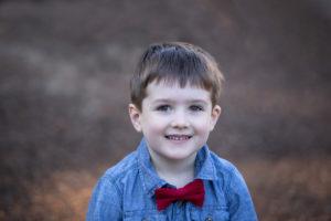 Color photo of sweet little boy with red bow tie West Linn cherry hills preschool