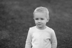 Black and white photo of angel face little boy Cherry Hills preschool West Linn