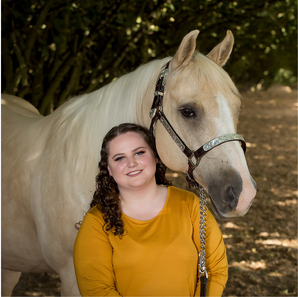 Portrait of senior girl with horse in hazelnut grove Canby