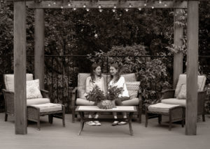 Portrait of Sisters visiting on outdoor furniture West Linn