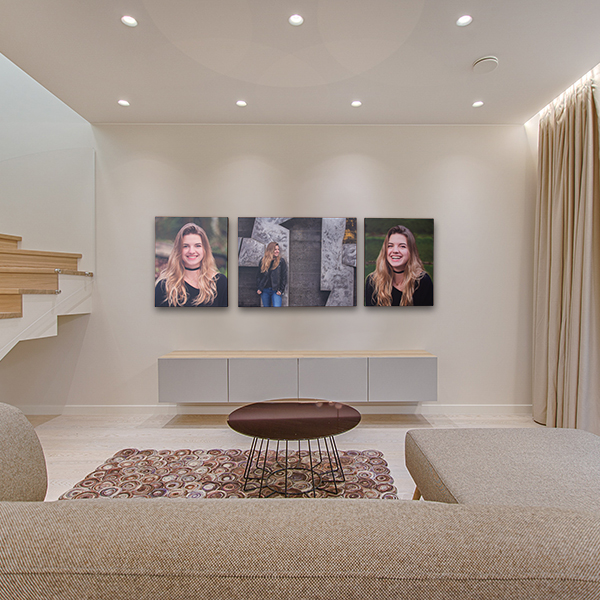 Large canvas portraits on living room wall